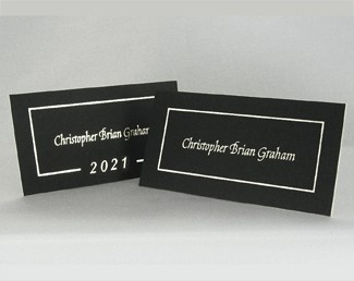 "Two black name cards: One is showing the ""Year"" Border and the other is showing the Foil Border around a student's name."
