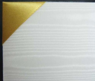 White silk moire panels are accented by gold satin corner ribbons.