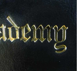 The Old English font is shown here with gold foil.